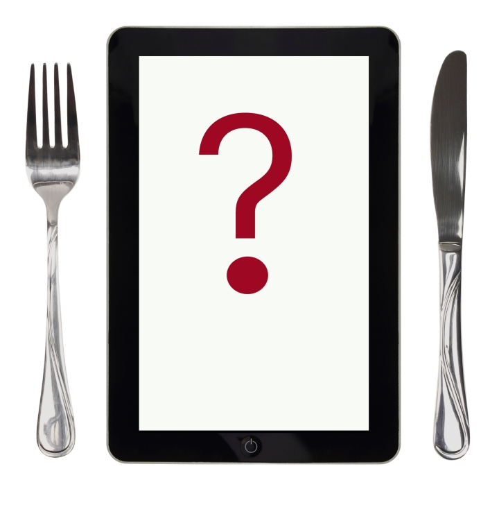 Tablet with food photo, fork and knife, conceptual