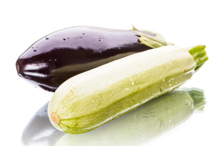 Eggplant and zucchini with reflection isolated on a white background